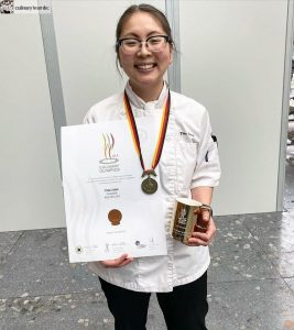 Chef Tina Tang, from Okanagan, B.C., shows off her bronze medal and certificate for competing in the 2020 IKA Culinary Olympics - Pastry Art.