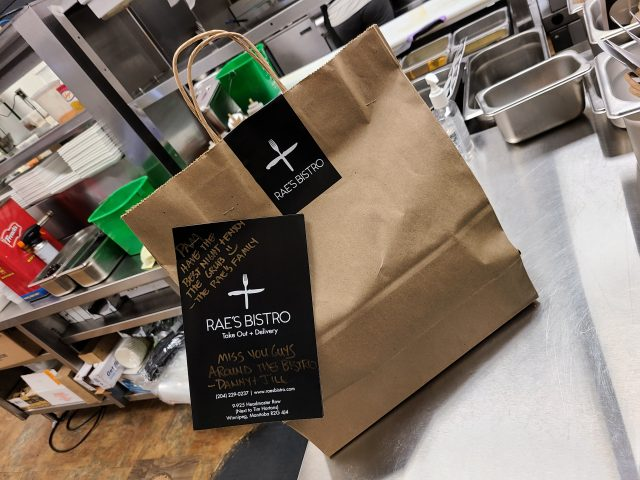 """A takeout order prepared by Rae's Bistro in Winnipeg sits at the restaurant's new """"takeout station"""" during COVID-19."""